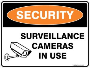 Security Surveillance Cameras In Use Sign